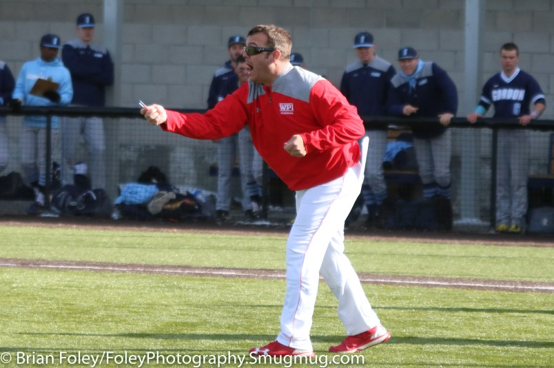 Monday, March 20, 2017; Northboro, MA; WPI Engineers head coach Mike Callahan goes out to argue a call with umpire Richard Galvin during the Engineers come from behind 9-7 victory over the Scots at the New England Baseball Complex.