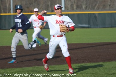 Monday, March 20, 2017; Northboro, MA; WPI Engineers third baseman Steven Gallagher (14) throws a ball home for a forceout during the Engineers come from behind 9-7 victory over the Scots at the New England Baseball Complex.