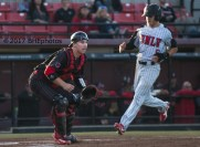 Kyle Isbel scores in the first inning as Hunter Stratton waits for the throw, - Photo By David Cohen, BHEphotos