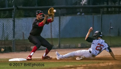 Ernie De La Trinidad beats the throw to Andrew Brown at 3rd. - Photo By David Cohen, BHEphotos