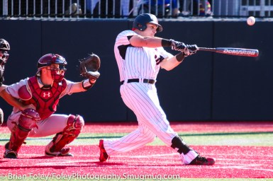 Friday, April 14, 2017; Brookline, MA; Northeastern Huskies infielder Cam Hanley (10) follows through on a hit during the Huskies 6-3 victory over the Cougars in a CAA matchup at Parsons Field.