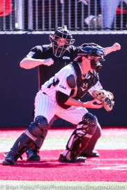 Friday, April 14, 2017; Brookline, MA; Northeastern Huskies catcher John Mazza (15) catches a strikeout with umpire Chris Marshall calling the batter out during the Huskies 6-3 victory over the Cougars in a CAA matchup at Parsons Field.