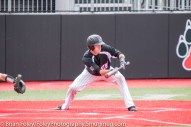 Sunday, April 16, 2017; Brookline, MA; Northeastern Huskies catcher John Mazza (15) squares to lay down a bunt during the Huskies 6-3 victory over the Cougars in a CAA matchup at Parsons Field.