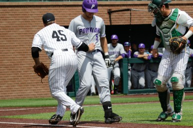 4/15/17: USF BASE vs Portland Pilots at Benedetti Diamond in San Francisco, CA. Portland wins 4-1. San Francisco Dons pitcher Daniel Slominski (45) tags Portland Pilots infielder Ryan Hoogerwerf (5) Image by Chris M. Leung for USF Dons Baseball