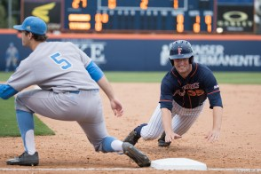 Zach Weller dives back into first base. CSUF defeated UCLA 4-3, Fullerton, CA, May 9, 2017. Photo by Steve Cheng, BHEphotos.