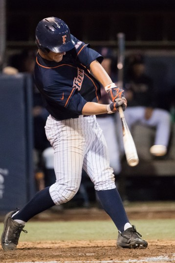 Zach Weller singles in a run in the 5th inning for a 3-0 lead. CSUF defeated UCLA 4-3, Fullerton, CA, May 9, 2017. Photo by Steve Cheng, BHEphotos.
