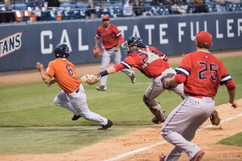 Scott Hurst is tagged out by catcher Jackson Thoreson after trying to score on an infield hit in the 5th inning. Saint Mary's defeated CSUF 12-4, Fullerton, CA, May 15, 2017. Photo by Steve Cheng, BHEphotos.