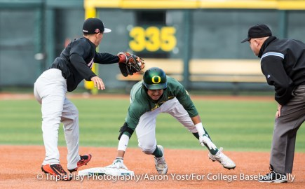 Oregon's Kyle Kasser reaches back to second after sliding past the bag on a steal attempt in the first inning of Thursday's Civil War game with Oregon State. OSU's Nick Madrigal just missed with the tag.