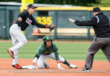 Second base umpire Travis Reininger calls Oregon's Kyle Kasser safe at second after OSU second baseman Nick Madrigal missed with a second tag after Kasser slid off the bag during the first inning of Thursday's Civil War game at PK Park.