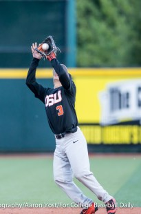 OSU second baseman Nick Madrigal pulls in a pop fly to end the second inning at PK Park against Oregon in Thursday's Civil War game.