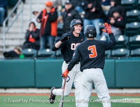 Oregon State third baseman Michael Gretler celebrates his solo home run with Nick Madrigal (3) during Thursday's Civil War game with Oregon at PK Park.