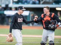 Oregon State left-hander Luke Heimlich and catcher Adley Rutschman celebrate the end of another inning against Oregon on Thursday at PK Park. Heimlich struck out seven, walked one and scattered seven hits in improving to 8-1 for No. 1 OSU.