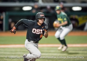 Oregon State's Cadyn Grenier (2) tries to beat out a bunt during the Beavers' 6-1 victory over Oregon at PK Park on Thursday.