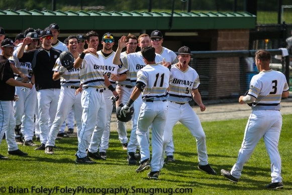 Thursday, May 18, 2017; Smithfield, RI; Bryant Bulldogs outfielder Nick Angelini (11) is greeted by his teammates after a home run during the Bulldogs 15-6 victory over the Rams.