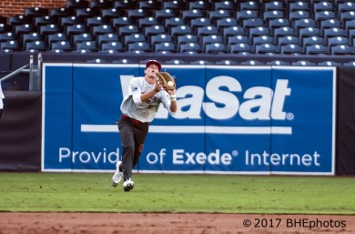 Nicholas Schnell can't hag onto the flay ball in left field. 2017 Perfect Game All American Game - Photo By David Cohen, BHEphotos