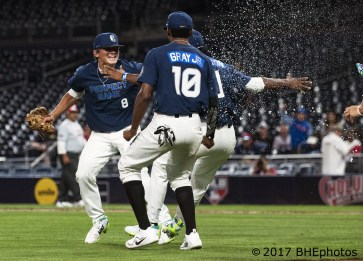 Seth Halvorsen, Joe Gray Jr and Osiris Johnson start the victory celebration 2017 Perfect Game All American Game - Photo By David Cohen, BHEphotos