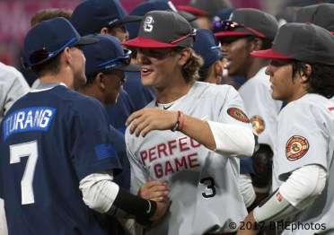 Blaze Alexander and Brice Turang hug after the game 2017 Perfect Game All American Game - Photo By David Cohen, BHEphotos