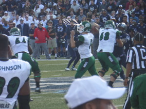 Charlotte QB Lee McNeil winds up to throw a pass over the middle.