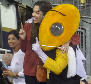 """GT mascot """"Buzz"""" posed with fans for photos during halftime."""