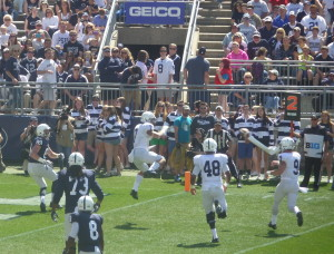Trace McSorley (9 in white) flips a TD pass to his TE Tom Pancoast ( 89 in Blue) as S Koa Farmer (7) defends.