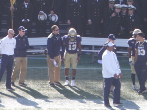 QB Keenan Reynolds (#19) graduated from USNA in 2016, but HC Ken Niumatalolo returns after turning down an opportunity to become HC at BYU after leading the Mids to an 11-2 record.