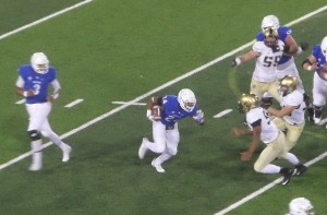 Bulls RB Jonathan Hawkins takes a handoff for a short gain in the second period.