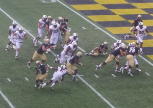 Navy FB Chris High nears UConn goal line in first half.