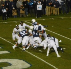 Saquon Barkley (26) takes it over the Spartan defense for the game's first touchdown.