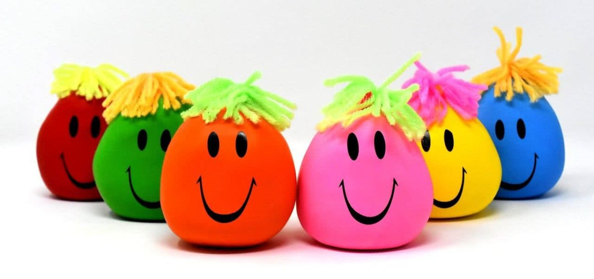 Six stress balls with smiley faces.