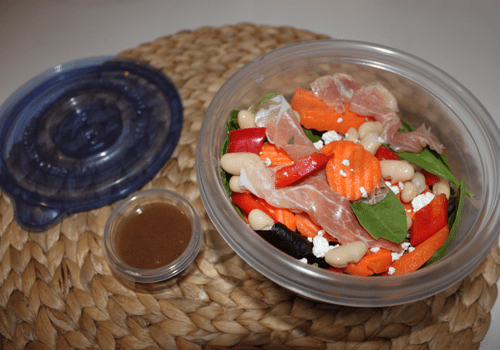 White bean, red pepper and prosciutto salad in a Glad salad bowl