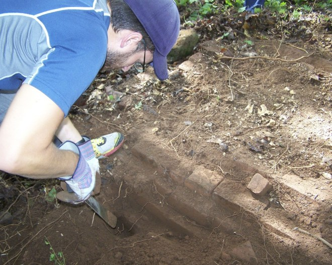 Josh Rhodes Cleans off the Grave of Robert Collier