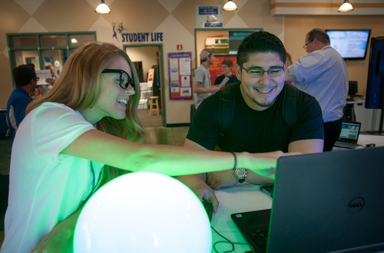 Anna Kessenich works with a student at the SmartBar.