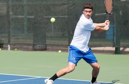 Collin College tennis player readying a backhand