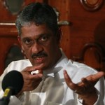Fonseka speaks to reporters during a news conference in Colombo