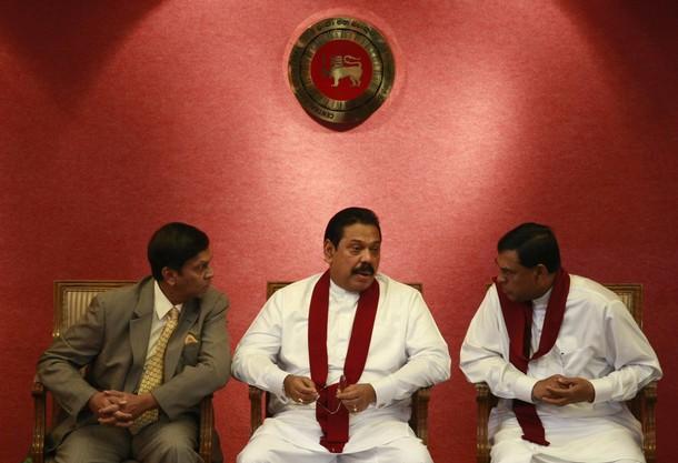 Rajapaksa, Cabraal, Basil Rajapaksa speak during the presentation of the Central Bank of Sri Lanka annual report 2010, in Colombo