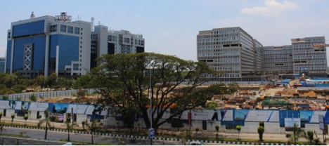 Ramanujan City on the right with Conference Hall and Residential Complex under construction in the foreground.  On the left is Tidel Park. Both are at Tharamani in the heart of the city.