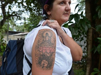 Naomi Coleman, 37, was arrested at Bandaranaike International Airport in Sri Lanka for 'hurting religious feelings' with her sleeve depicting Buddha on a lotus flower