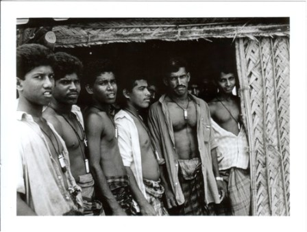 TIGER FIGHTERS WITH CYANIDE CAPSULES                                                                                       IN CAMP, c. 1989                                                                                                                                         Photo by SHYAM TEKWANI, an Indian journalist                                                                   embedded within LTTE during war against IPKF.