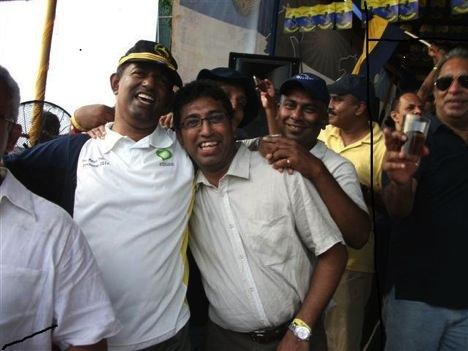 Captain Pujitha Jayakody (with beer in hand) loves hanging out with 'Yahapalanaya' big boys now. This is one of his proud Facebook postings where he was at seen at the Royal / Thomian 'Big Match' hob knobbing Deputy Minister  Dr. Harsha De Silva.