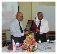 T. Kandasamy Receiving Award from Dr. L.N. Senaweera Director General SLSI