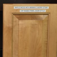 Door Stain & White Molding Around A Wood Stained Door-