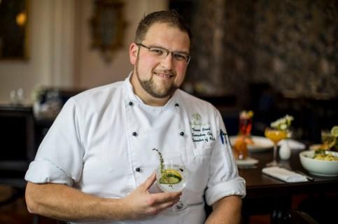Chef Travis holding a citrus spritzer
