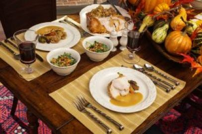 Two table settings with holiday turkey dinner