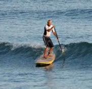 man kayaking on beach