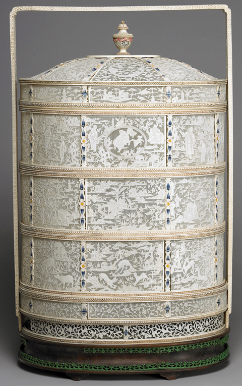 Ivory four-tiered food carrying case in openwork relief
