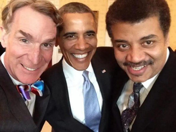two african americans and one white guy smiling at camera