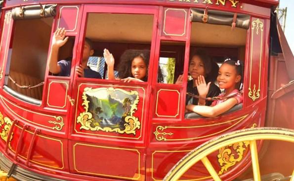 A red carriage with children in it