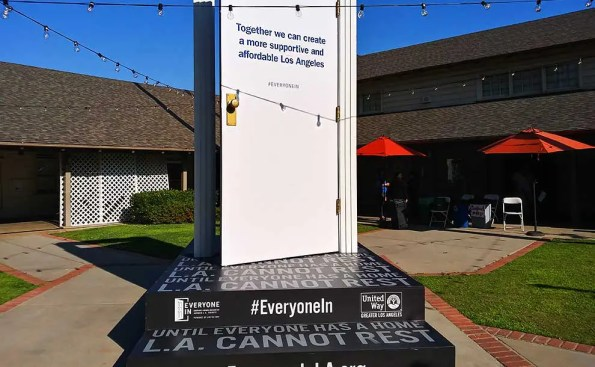 A white door wth words that support finding homes for homeless in Los Angeles