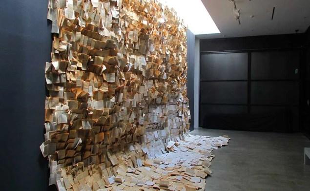 an art piece of a watrefall of books