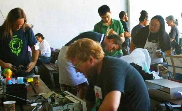 People repairing items